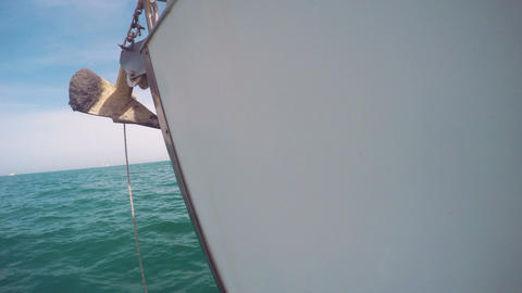 Closeup sideview of a anchor in the prow of a sailboat that sail in mediterranea Footage