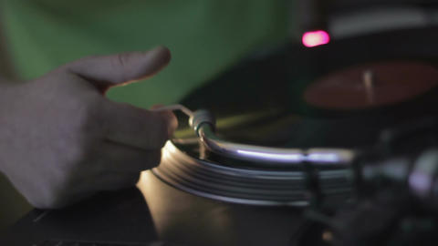 DJ hands performing music at cool nightclub. Spinning vinyl record, nightlife Footage