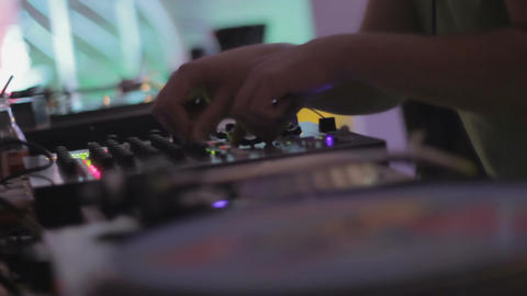 Male DJ playing music at nightclub. Closeup of creative vinyl record design Footage