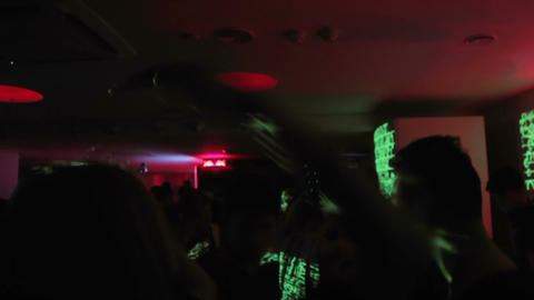 People partying and relaxing at night club. Led illumination and flashing lights Footage