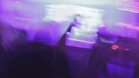 Time-lapse shot of atmosphere in cool night club, people chatting and dancing Live Action