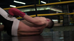 Boxer falling down boxing ring floor after knockout punch HD slow motion video Footage