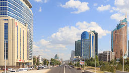 City traffic. Clouds over the city. Zoom. Kunaev Avenue, Astana, Kazakhstan. Tim Footage