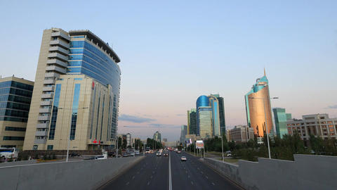 City traffic at Sunset. Kunaev Avenue, Astana, Kazakhstan. Zoom. Time Lapse Footage