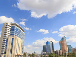 Clouds over the skyscrapers. Kunaev Avenue, Astana, Kazakhstan. Time Lapse Footage