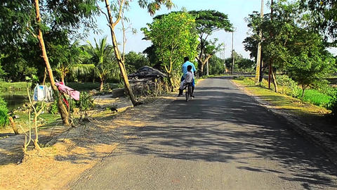 Wide road scape of rural Bengal through a moving vehicle Footage