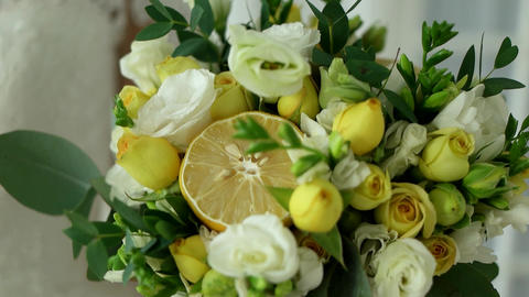 Closeup bouquet of roses and flowers with lemon close-up with a blur effect Live Action