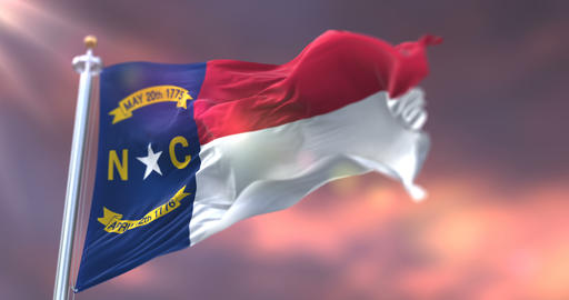 Flag of american state of North Carolina waving at sunset - loop Animation