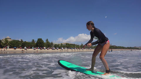 Girl surfing in the ocean Live Action