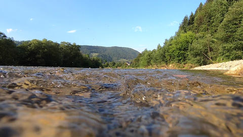 Mountain river water flow, view above water surface, close to water surface Live Action