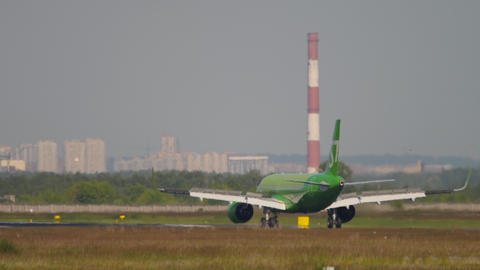 S7 Airlines Airbus A320 airliner deccelerating after landing Live Action