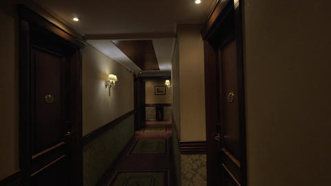 Seen long hotel corridor with glowing lights and doors from the rooms Footage
