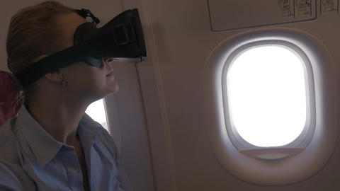 Woman exploring virtual world during the flight Image