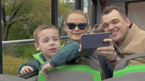 In Vienna, Austria in an open bus rides a young family with a little son Footage