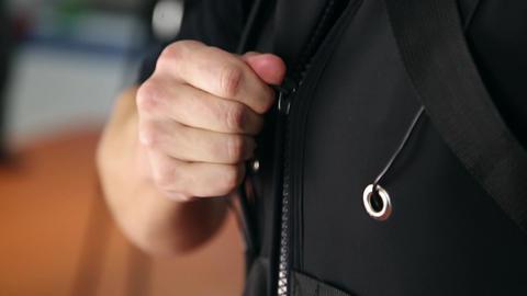 Man buttoning a zipper Footage