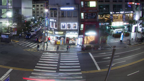 Timelapse of cars and pedestrians traffic on night road in Seoul, South Korea Footage