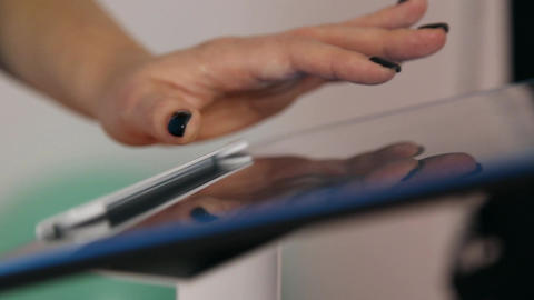 The girl works with a tablet touchscreen Live Action