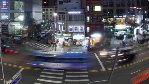 Time lapse shot of T junction with pedestrian crossing and shop front and billbo Footage