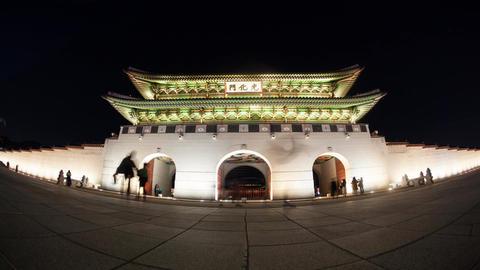 Timelapse of people at Seoul landmark Gwanghwamun Gate at night GIF