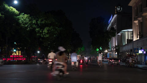 Timelapse of night city, seen busy road with passing cars, motorcycles and cycli Footage