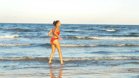 Young women playing in the ocean Footage