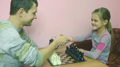 Pope explains a better daughter to make a move in the game of chess Footage