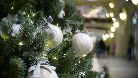 White wool balls and lights. New Year's and abstract blurred shopping mall backg Footage