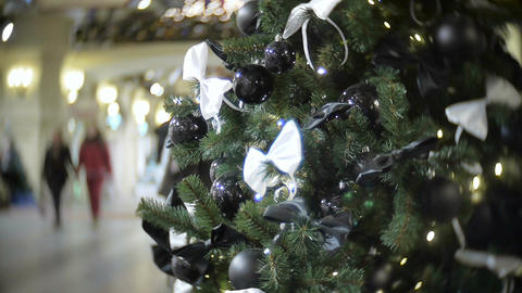 Black shiny and matte balls and white bow. New Year's and abstract blurred shopp Footage