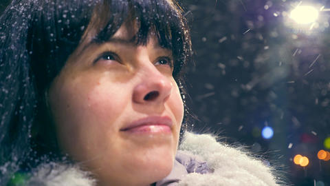 Happy Beautiful Girl Smiling Looking Up During Blizzard Snowfall Young Adult Cold Winter Night City Live Action