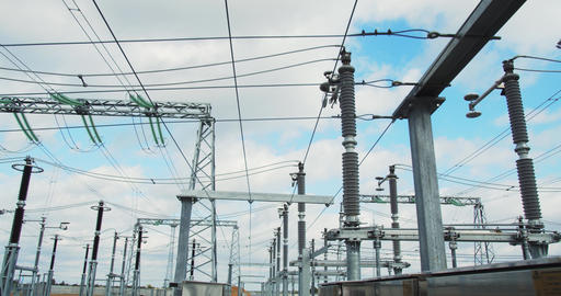 Footage of a massive power station with big metal structures and power lines, 4k Live Action
