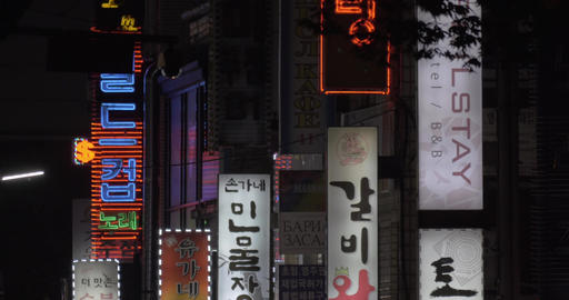 Store banners and cars passing by in Seoul, South Korea Footage