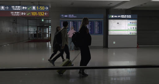 People with luggage walking in airport terminal of Seoul, South Korea Footage