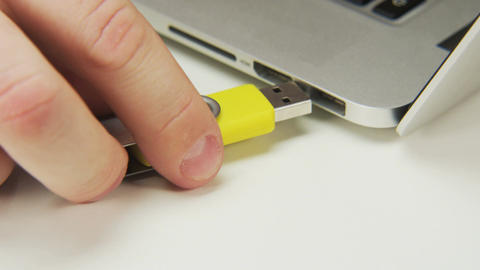 Unplugging and Plugging a Yellow Pen Drive Footage