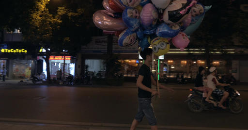 Street vendor with bunch of balloons in Hanoi, Vietnam Footage