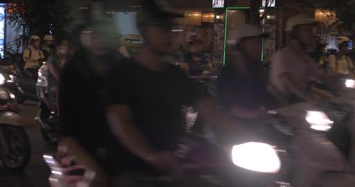 Stream of bikes and cars in night Hanoi, Vietnam Footage