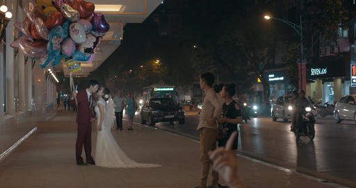 Wedding couple with balloons having photo shoot. Hanoi, Vietnam Footage