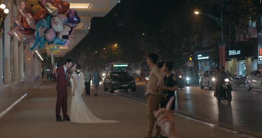 Wedding couple with balloons having photo shoot. Hanoi, Vietnam Footage
