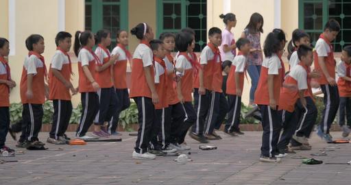 Children pioneers doing exercise outdoor. Hanoi, Vietnam Footage