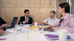 Cheerful team of business people in meeting room Live Action