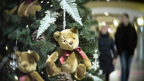 Plush bear balls and fir cone. New Year's and abstract blurred shopping mall bac Footage