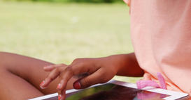 Close up of little girl using a tablet computer Live Action