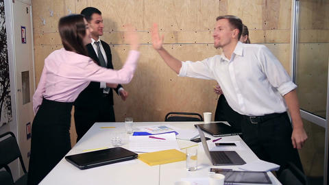 Happy business team celebrating success in office Footage