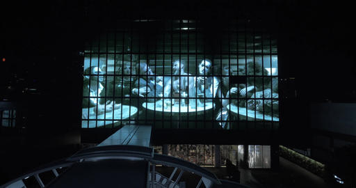 Film trailer shown on huge city display at night Footage