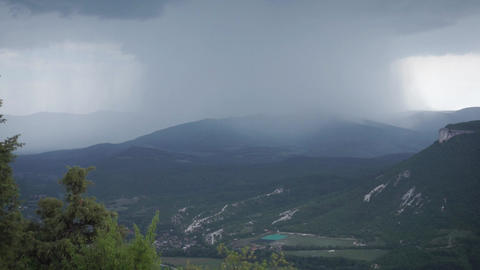 Sky full of rain cloud in mountains. Footage. Sky and mountain background Live Action