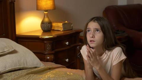 Little girl praying at bedtime, Little girl prays before bedtime, 4k Live Action