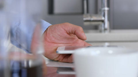 Close-up of businessman hands using a digital tablet ビデオ