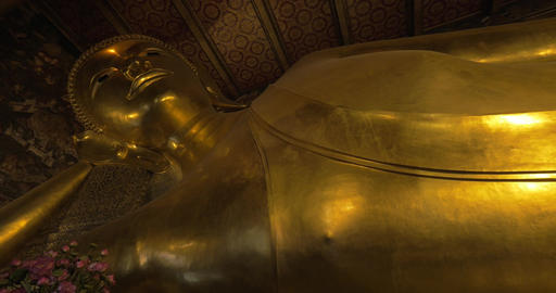 Statue of reclining Buddha in Wat Pho temple, Bangkok Footage