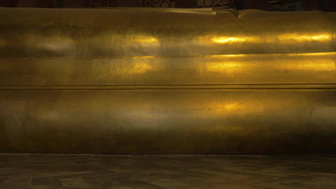 Seen a large golden statue of the reclining Buddha Footage