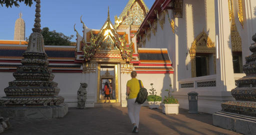 Woman visiting Buddhist Marble Temple in Bangkok, Thailand Footage