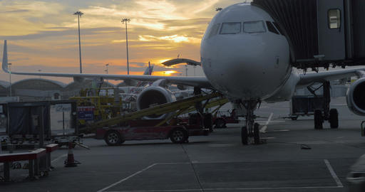 Timelapse of loading airplane at sunset Footage